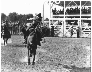Alice Greenough riding bronc